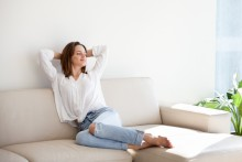 woman relaxing comfortably at home, clean healthy home