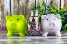 green energy savings concept with piggy banks