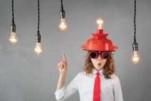 funny child with lightbulb on head, comical home power concept