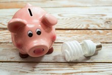 piggy bank and energy efficient light bulb, saving energy concept