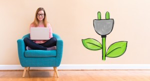 woman in chair next to green energy symbol