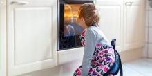 Kid Sitting and Waiting By Oven