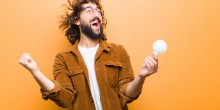 man with lightbulb very excited