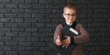 little business boy with clipboard