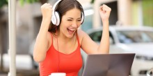 woman excited while listening to computer