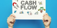 Person holding a cash flow sign | Cash Flow Home Energy