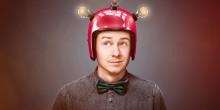 man wearing helmet with lightbulbs on it