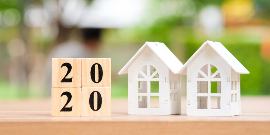 "two toy houses next to blocks reading ""2020"""