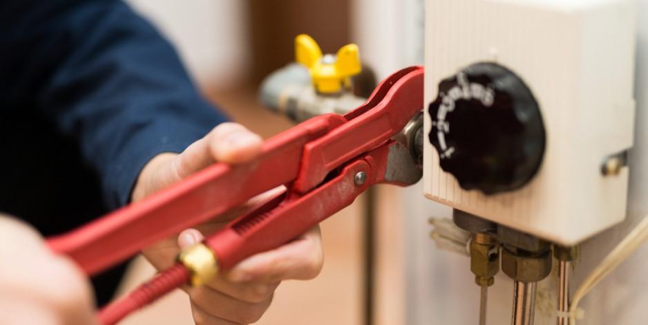 tech servicing a water heater